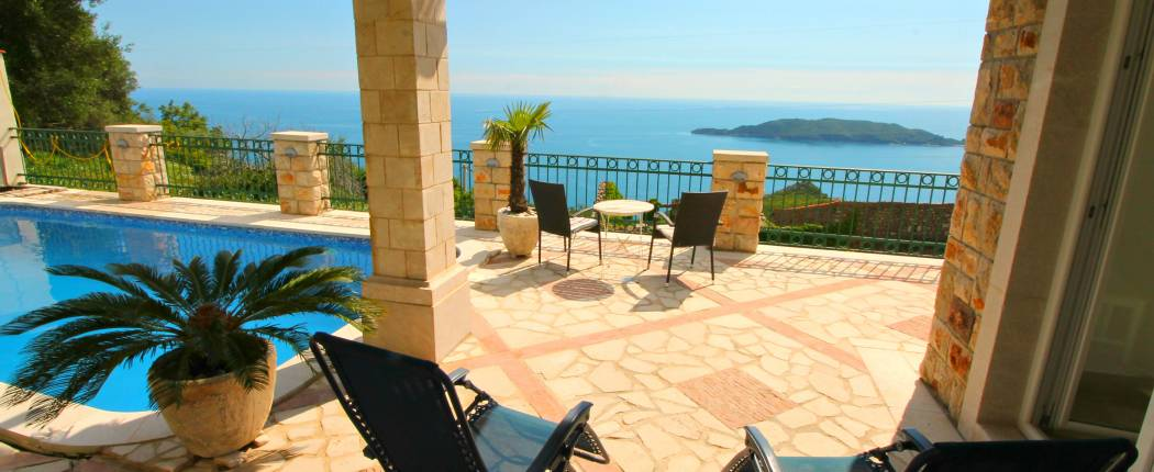 Front terrace with pool and sea view